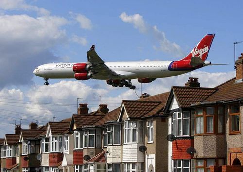 1-a-virgin-atlantic-airline-aircraft-comes-in-to-land-at-heathrow-airport-in-london_141