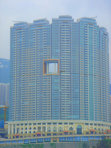 A building in hong kong with a hollow middle hole for Feng shui in building a house